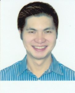 A person smiling for the camera Description automatically generated with low confidence